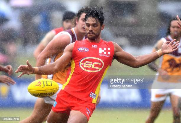Aaron Hall of the Suns kicks the ball during the JLT Community Series AFL match between the Gold Coast Suns and the Brisbane Lions at Fankhauser...