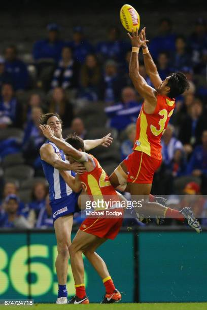 Aaron Hall of the Suns marks the ball during the round six AFL match between the North Melbourne Kangaroos and the Gold Coast Suns at Etihad Stadium...