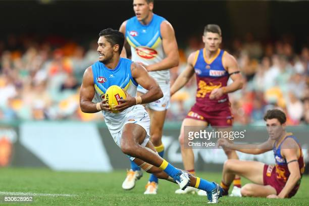 Aaron Hall of the Suns runs the ball during the round 21 AFL match between the Brisbane Lions and the Gold Coast Suns at The Gabba on August 12 2017...