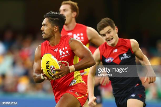 Aaron Hall of the Suns runs the ball during the round eight AFL match between the Gold Coast Suns and the Melbourne Demons at The Gabba on May 12...