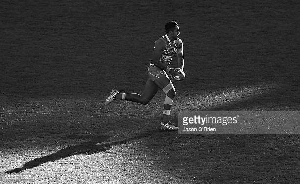 Aaron Hall of the suns runs with the ball during the round 15 AFL match between the Gold Coast Suns and the St Kilda Saints at Metricon Stadium on...