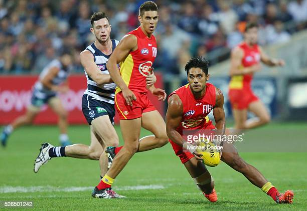 Aaron Hall of the Suns runs with the ball during the round six AFL match between the Geelong Cats and the Gold Coast Suns at Simonds Stadium on April...