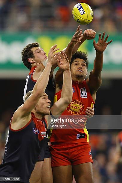 Aaron Hall of the Suns spoils a mark from James Strauss of the Demons during the round 20 AFL match between the Gold Coast Suns and the Melbourne...