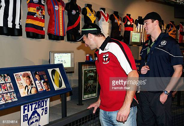 Aaron Hamill of St Kilda and Trent Sporn of Carlton look at the exhibits during the launch of the AFL Hall of Fame and Sensation at the QV Building...
