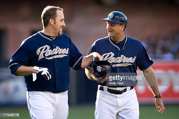 Aaron Harang and Glenn Hoffman of the San Diego Padres share a laugh against the Houston Astros on June 4 2011 at Petco Park in San Diego California...