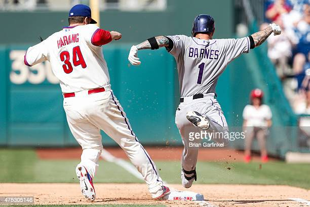Aaron Harang of the Philadelphia Phillies forces Brandon Barnes of the Colorado Rockies out at first in the fifth inning of the game at Citizens Bank...