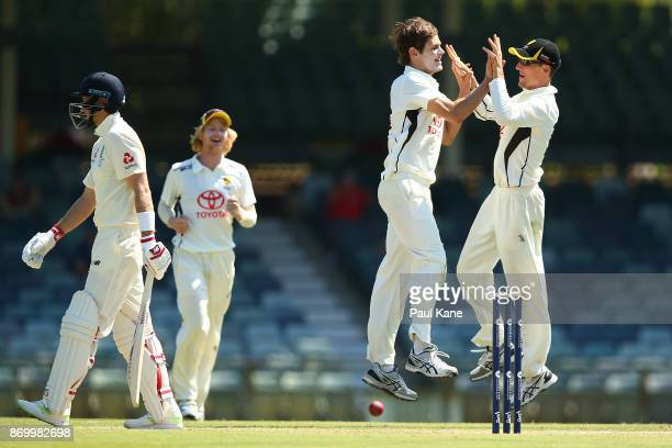 Aaron Hardie and Nick Hobson of the WA XI celebrate the wicket of Joe Root of England during day one of the Ashes series Tour Match between Western...