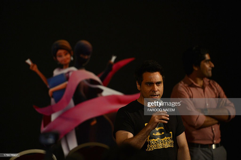 Aaron Haroon Rashid, one of Pakistan's biggest pop star speaks at the press presentation of cartoon show Burka Avenger in Rawalpindi on August 4, 2013. A new cartoon superhero disguised in a flowing black burka is set to debut on Pakistani television next month in an animated series which follows her battle for girls education in Pakistan. AFP PHOTO/Farooq NAEEM