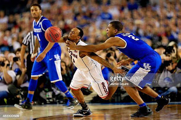 Aaron Harrison of the Kentucky Wildcats defends against Ryan Boatright of the Connecticut Huskies during the NCAA Men's Final Four Championship at...