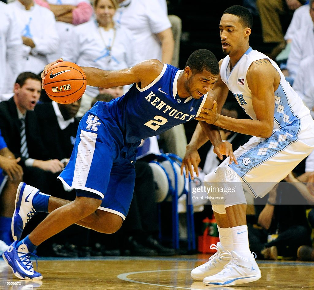 Aaron Harrison #2 of the Kentucky Wildcats drives against J.P. Tokoto #13 of the North Carolina Tar Heels during play at the Dean Smith Center on December 14, 2013 in Chapel Hill, North Carolina. North Carolina won 82-77.