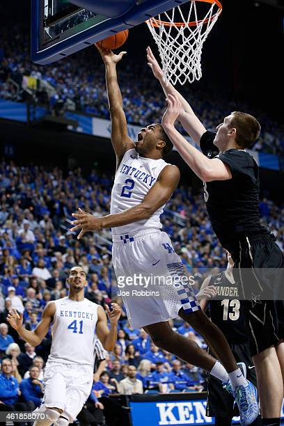 Aaron Harrison of the Kentucky Wildcats drives to the basket against Luke Kornet of the Vanderbilt Commodores during the game at Rupp Arena on...