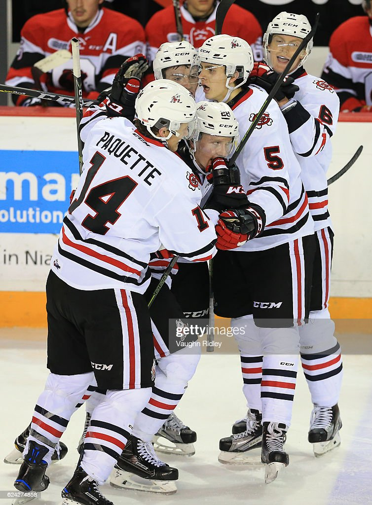Aaron Haydon #28 of the Niagara IceDogs celebrates a goal with teammates during the third period of an OHL game against the Ottawa 67's at the Meridian Centre on November 18, 2016 in St Catharines, Canada.
