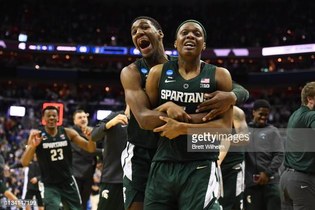 Aaron Henry and Cassius Winston of the Michigan State Spartans in the Elite Eight round of the 2019 NCAA Photos via Getty Imagess via Getty Images...
