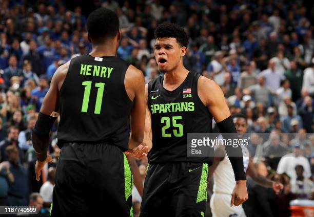Aaron Henry and Malik Hall of the Michigan State Spartans celebrate the win over the Seton Hall Pirates at Prudential Center on November 14, 2019 in...