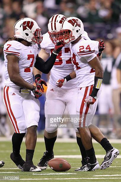 7b122fc31 Aaron Henry Ethan Hemer and Shelton Johnson of the Wisconsin Badgers  celebrate after Johnson intercepted a