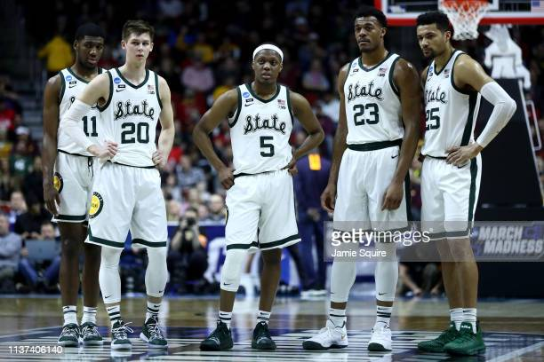 Aaron Henry Matt McQuaid Cassius Winston Xavier Tillman and Kenny Goins of the Michigan State Spartans stand on the court during their game in the...