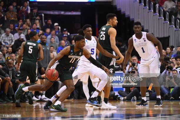 Aaron Henry of the Michigan State Spartans dribbles around the perimeter in front of RJ Barrett of the Duke Blue Devils in the Elite Eight round of...