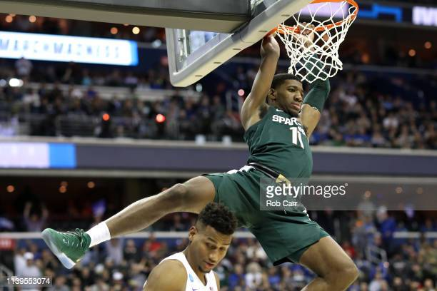 Aaron Henry of the Michigan State Spartans dunks the ball against the Duke Blue Devils during the second half in the East Regional game of the 2019...