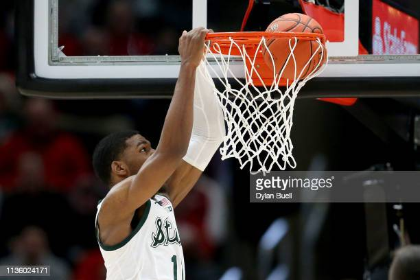 Aaron Henry of the Michigan State Spartans dunks the ball in the second half against the Ohio State Buckeyes during the quarterfinals of the Big Ten...