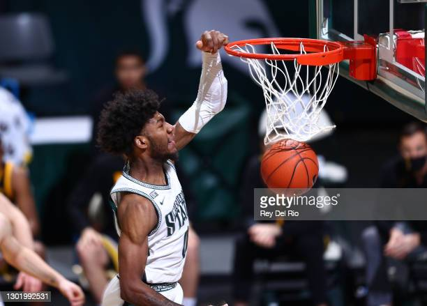 Aaron Henry of the Michigan State Spartans dunks the ball in the first half against the Iowa Hawkeyes at Breslin Center on February 13, 2021 in East...