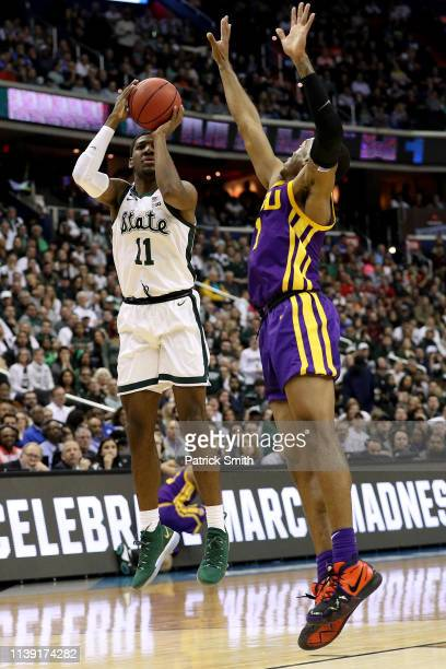 Aaron Henry of the Michigan State Spartans shoots the ball against Javonte Smart of the LSU Tigers during the first half in the East Regional game of...