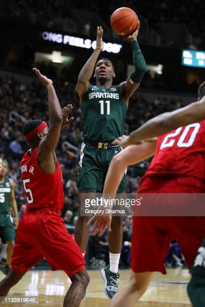 Aaron Henry of the Michigan State Spartans takes a shot over Glynn Watson Jr #5 of the Nebraska Cornhuskers during the first half at Breslin Center...