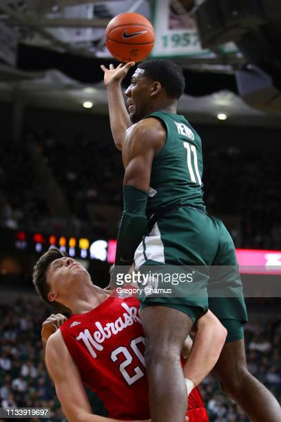 Aaron Henry of the Michigan State Spartans tries to get a first half shot off around Tanner Borchardt of the Nebraska Cornhuskers at Breslin Center...