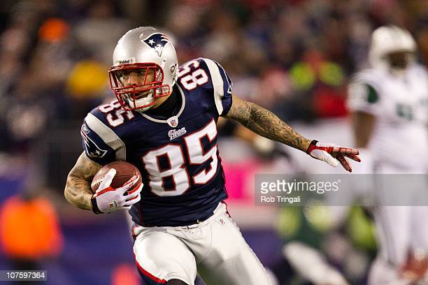 Aaron Hernandez of the New England Patriots runs with the ball after a reception against the New York Jets during the game at Gillette Stadium on...