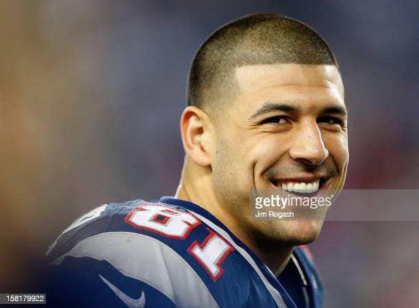 Aaron Hernandez of the New England Patriots smiles from the sidelines in the fourth quarter during a game against the Houston Texans at Gillette...