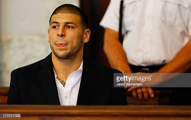 Aaron Hernandez sits in the courtroom of the Attleboro District Court during his hearing on August 22 2013 in North Attleboro Massachusetts Former...