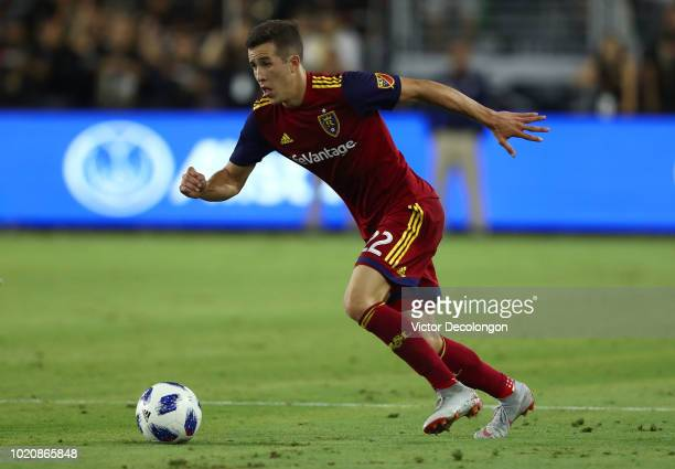 Aaron Herrera of Real Salt Lake plays the ball forward at midfield during the first half of the MLS match against Los Angeles FC at Banc of...