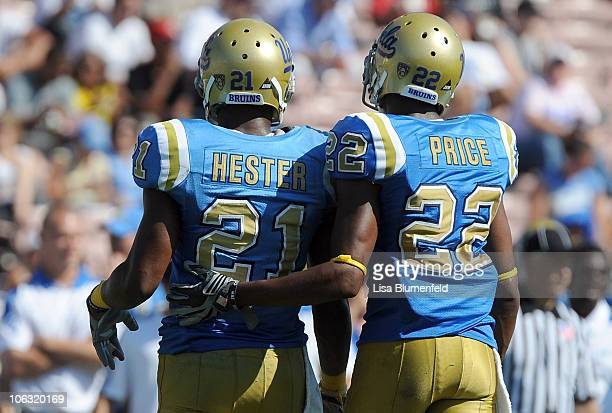 Aaron Hester and teammate Sheldon Price of the UCLA Bruins walk to the sideline during the game against the Washington State Cougers at The Rose Bowl...
