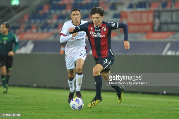 Aaron Hickey of Bologna FC competes for the ball with Gabriele Zappa of Cagliari Calcio during the Serie A match between Bologna FC and Cagliari...