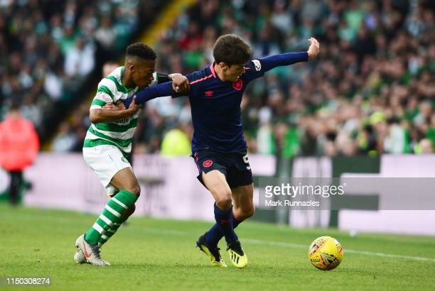 Aaron Hickey of Hearts holds off Karamoko Dembele of Celtic during the Ladbrokes Scottish Premiership match between Celtic and Hearts at Celtic Park...