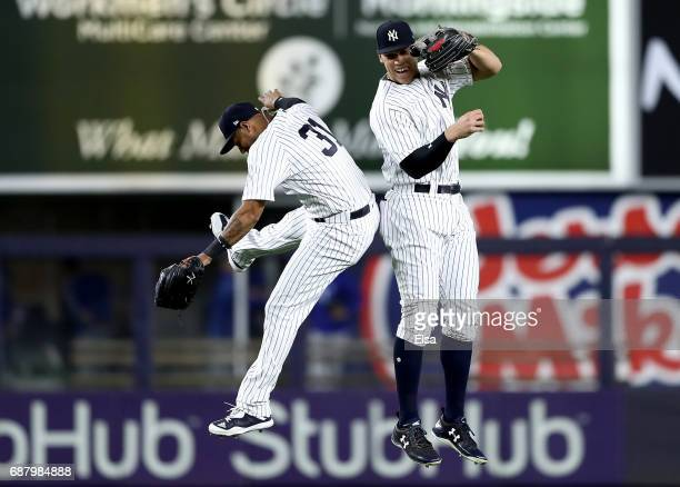 Aaron Hicks and Aaron Judge of the New York Yankees celebrate the 30 win over the Kansas City Royals on May 24 2017 at Yankee Stadium in the Bronx...