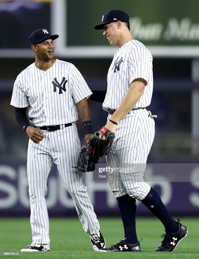Aaron Hicks #31 and Aaron Judge #99 of the New York Yankees celebrate the 4-2 win over the Kansas City Royals on May 22, 2017 at Yankee Stadium in the Bronx borough of New York City.