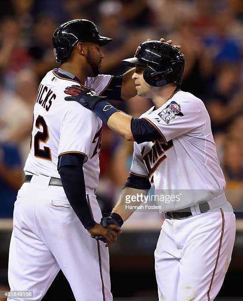 Aaron Hicks and Brian Dozier of the Minnesota Twins celebrate scoring on a tworun home run against the New York Yankees by Dozier during the eighth...