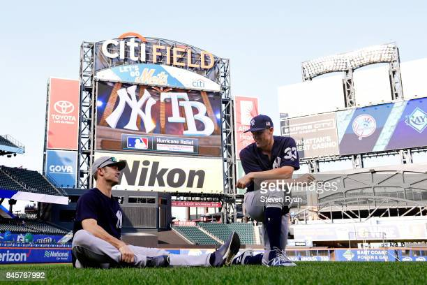 Aaron Hicks and Greg Bird of the New York Yankees warm up prior to the game against the Tampa Bay Rays at Citi Field on September 11 2017 in the...