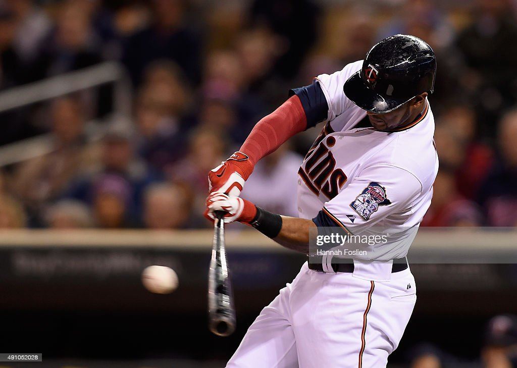 Aaron Hicks #32 of the Minnesota Twins hits an RBI single against the Kansas City Royals during the first inning of the game on October 2, 2015 at Target Field in Minneapolis, Minnesota.