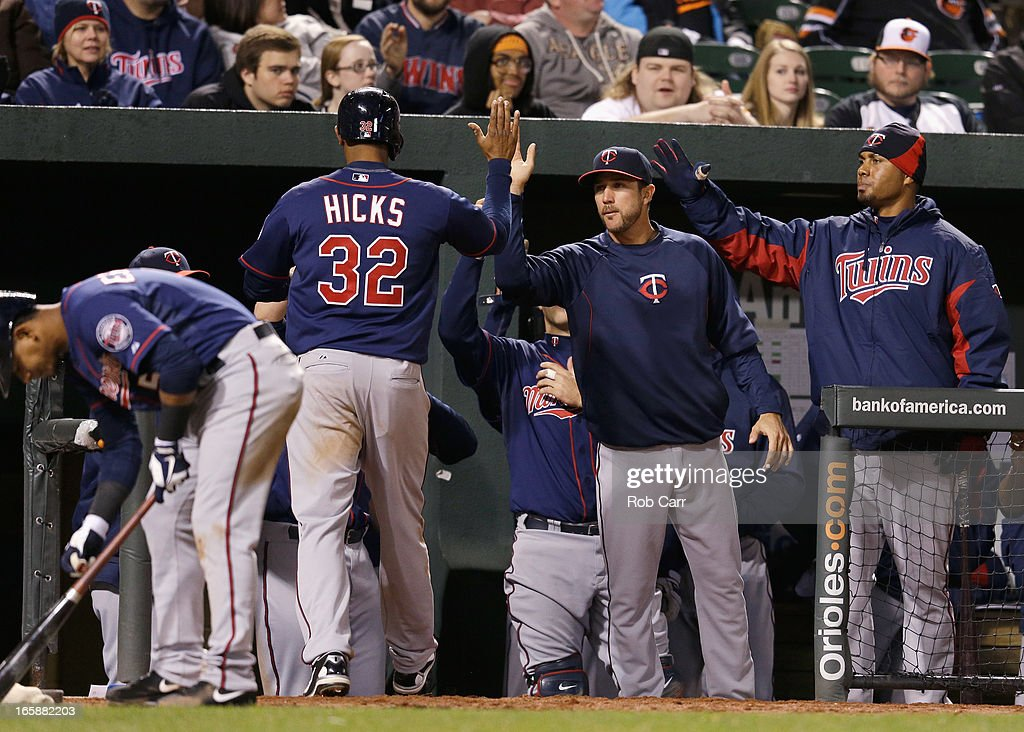 Aaron Hicks #32 of the Minnesota Twins is congratulated after scoring the go ahead run in the ninth inning to give the Twins a 6-5 win over the Baltimore Orioles at Oriole Park at Camden Yards on April 6, 2013 in Baltimore, Maryland.