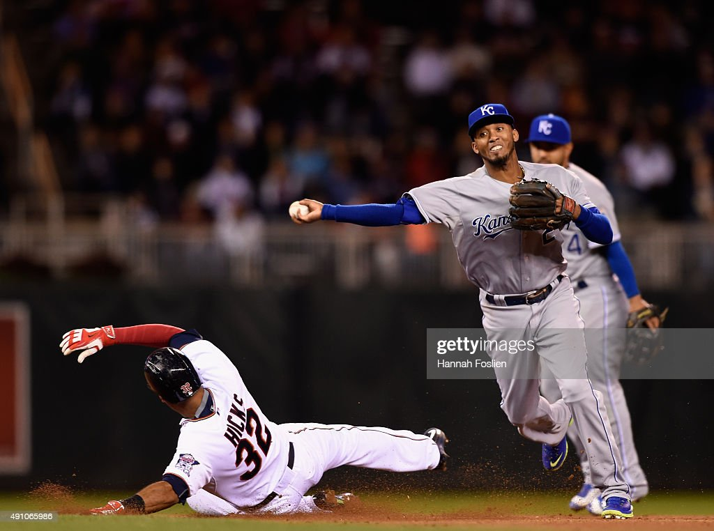 Aaron Hicks #32 of the Minnesota Twins is out at second base as Alcides Escobar #2 of the Kansas City Royals turns a double play during the seventh inning of the game on October 2, 2015 at Target Field in Minneapolis, Minnesota. The Royals defeated the Twins 3-1.