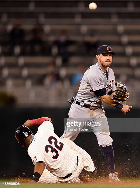 Aaron Hicks of the Minnesota Twins is out at second base as Ian Kinsler of the Detroit Tigers throws to first base to complete a double play to end...