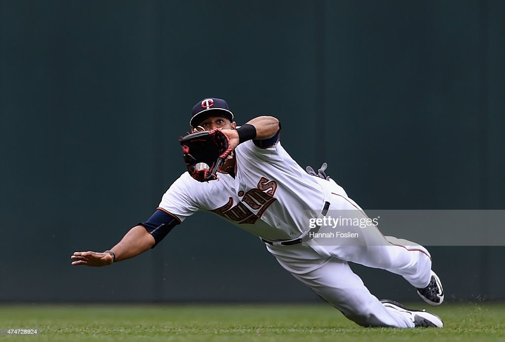Aaron Hicks #32 of the Minnesota Twins makes a catch of the ball hit by Daniel Nava #29 of the Boston Red Sox in center field during the second inning of the game on May 25, 2015 at Target Field in Minneapolis, Minnesota.