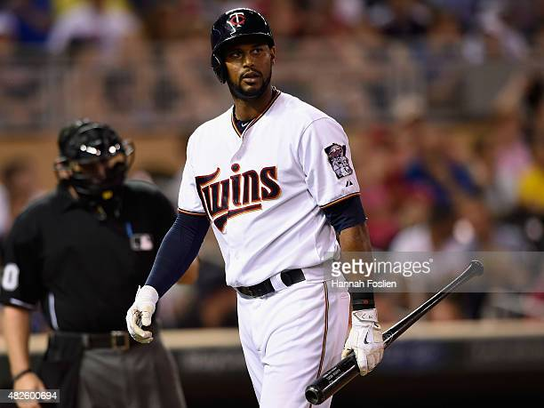 Aaron Hicks of the Minnesota Twins reacts to striking out against the Seattle Mariners during the ninth inning of the game on July 31 2015 at Target...