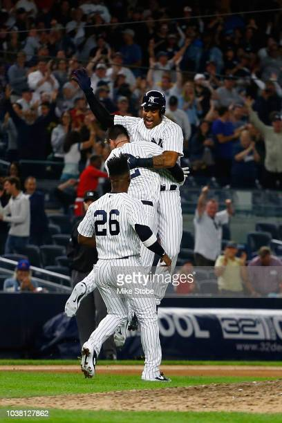 Aaron Hicks of the New York Yankees celebrates after hitting a game winning walkoff double in the eleventh inning against the Baltimore Orioles at...
