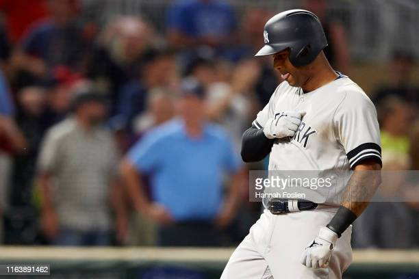 Aaron Hicks of the New York Yankees celebrates after hitting a home run against the Minnesota Twins during the game on July 23 2019 at Target Field...