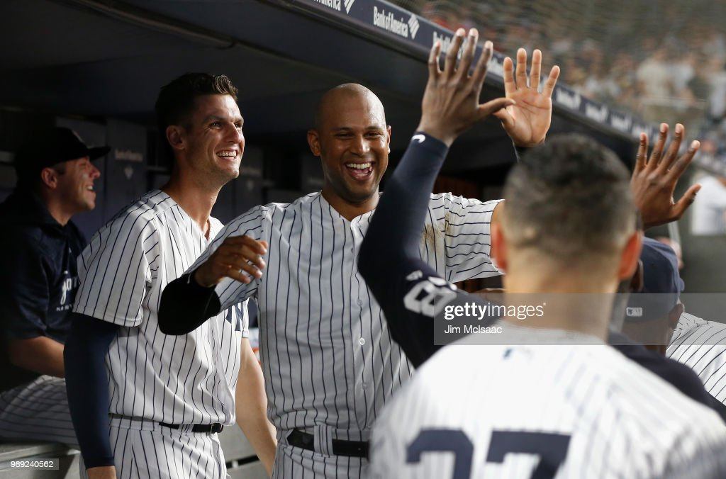 Aaron Hicks #31 of the New York Yankees celebrates his eighth inning home run, his third of the game, against the Boston Red Sox with his teammates in the dugout at Yankee Stadium on July 1, 2018 in the Bronx borough of New York City.