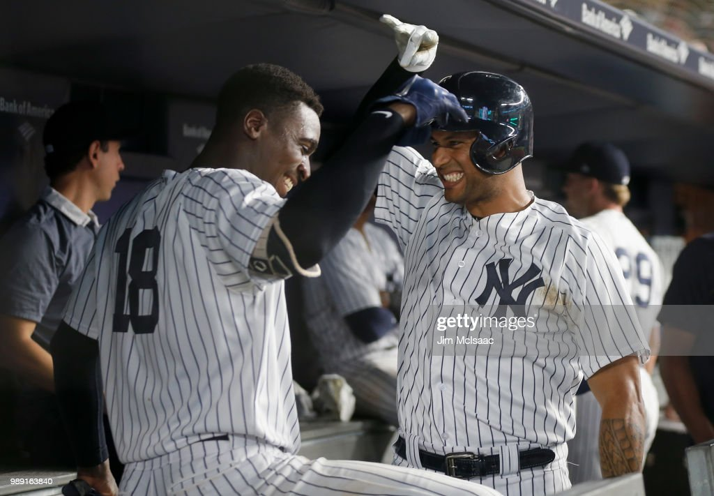 Aaron Hicks #31 of the New York Yankees celebrates his fourth inning home run against the Boston Red Sox in the dugout with teammate Didi Gregorius #18 at Yankee Stadium on July 1, 2018 in the Bronx borough of New York City.