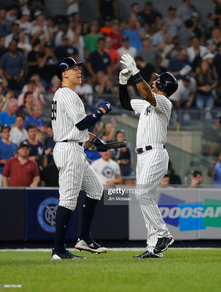Aaron Hicks #31 of the New York Yankees celebrates his second inning two run home run against the Boston Red Sox with teammate Aaron Judge #99 at Yankee Stadium on July 1, 2018 in the Bronx borough of New York City.