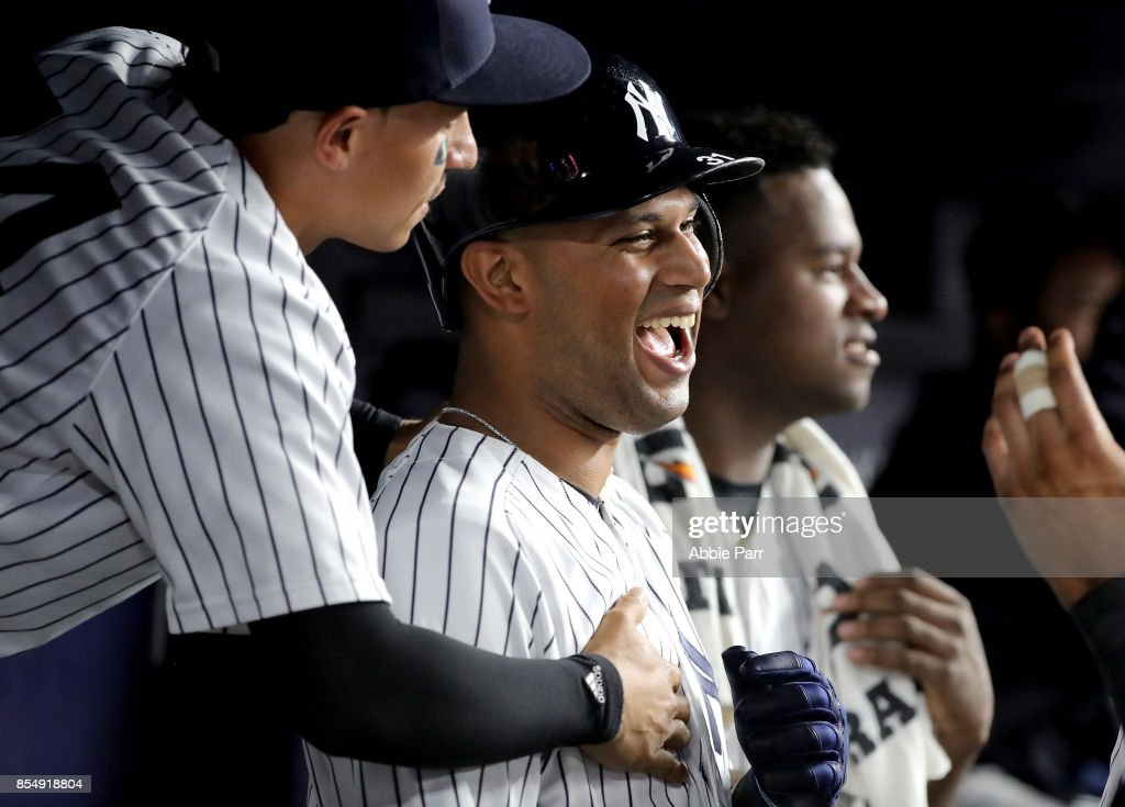 Aaron Hicks #31 of the New York Yankees celebrates in the dugout after hitting a two run home run against Xavier Cedeno #31 of the Tampa Bay Rays in the sixth inning at Yankee Stadium on September 27, 2017 in the Bronx borough of New York City.